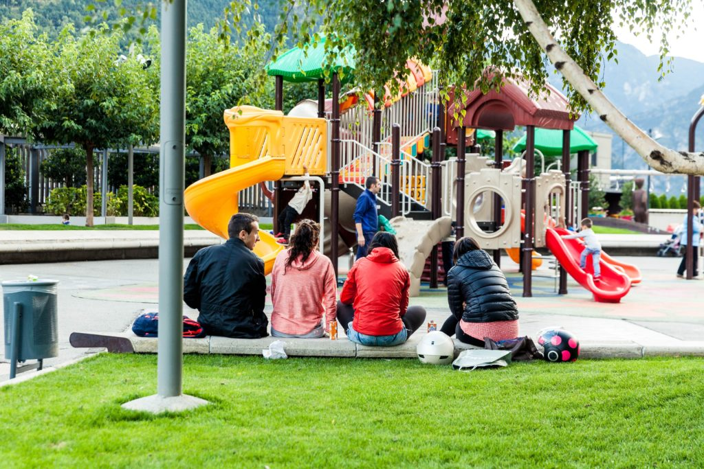 teens sitting by playground